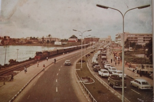 "Meeting of the ""WAYs"" Water, Rail. Road , Old Lagos."
